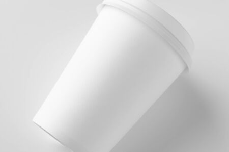 12 oz. white coffee paper cup mockup with lid. Banco de Imagens