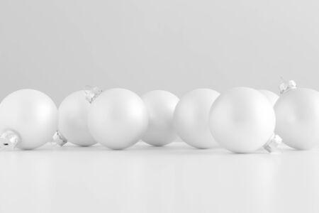 Multiple white matte christmas balls. Фото со стока