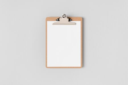 Wooden clipboard mockup with a blank paper. Top view.