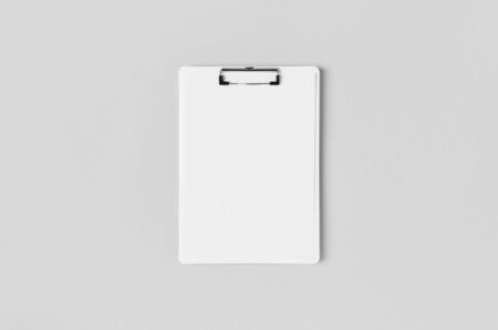 White clipboard mockup with a blank paper. Top view.