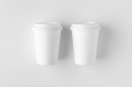 Top view of a 12 oz. white coffee paper cup mockup with lid. Фото со стока