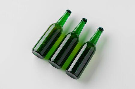 Green longneck beer bottle mockup. Three bottles. 写真素材