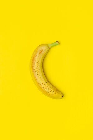 Ripe banana on a yellow background. 写真素材