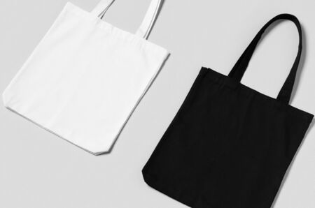 White and black tote bags mockup on a grey background. Stock Photo - 140724976