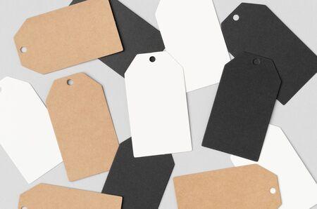 Multiple white, black and kraft clothing or gift tags mockup. Banco de Imagens