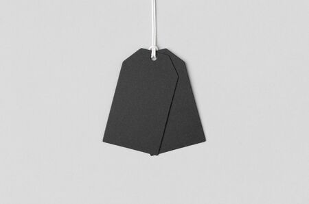 Black clothing or gift tag mockup. Banco de Imagens