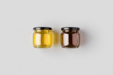 Honey jars mockup on a grey background. Two different colors.