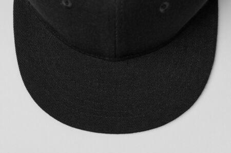 Black snapback cap mockup closeup.
