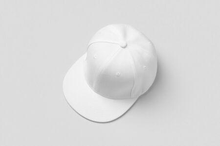White snapback cap mockup on a grey background. 版權商用圖片
