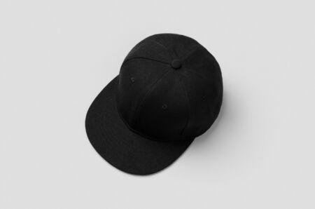 Black snapback cap mockup on a grey background. 版權商用圖片