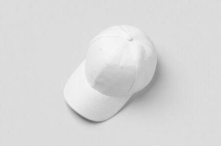 White baseball cap mockup on a grey background. 版權商用圖片