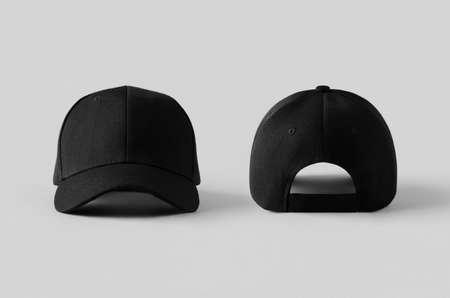 Black baseball caps mockup on a grey background, front and back side. Reklamní fotografie