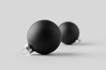 Two black matte Christmas balls mockup on a seamless grey background.