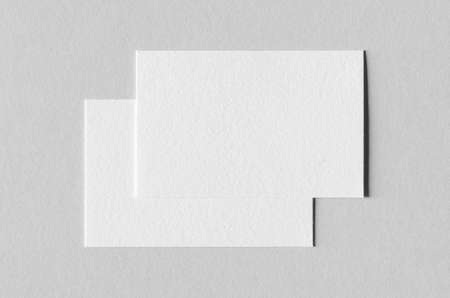 Textured business card mockup on a grey background.  85x55 mm.