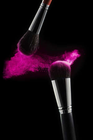 Makeup brush with pink powder isolated on white. Professional cosmetic brushes Standard-Bild