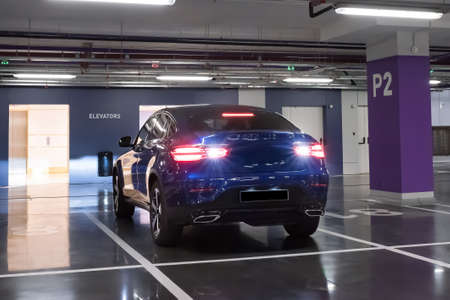 Blue car on the underground parking.
