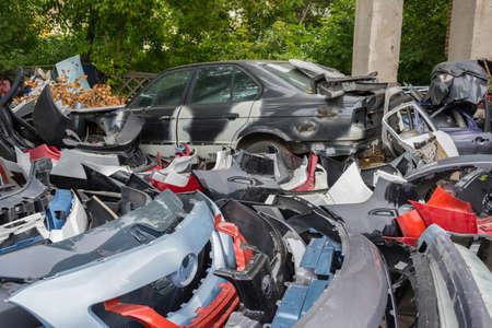 Scrapyard of bumpers. Motor-car dump, cemetery.