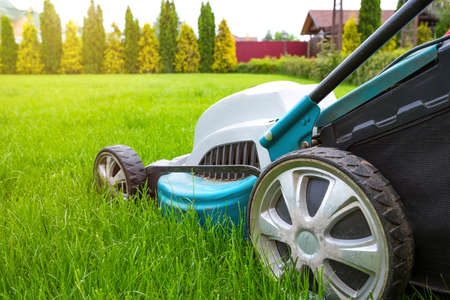 Lawn mowers close-up on a sunny day. Grass care. Gardening concept.