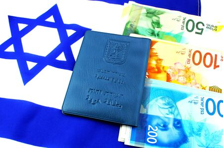 Passport Israel on the IsraelI flag and Israeli shekel (currency ILS). (passport booklet, translate from the Hebrew and Arabic: Ministry of Interior, ID). Themes: economy, business, citizenship