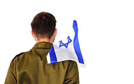 Soldier Israel Defense Forces with flag of Israel. IDF soldier in uniform holds Israeli flag. Image on a white isolated background. Jewish soldier