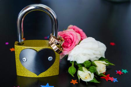 Wedding rings on a lock