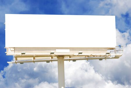 Blank billboard against a partly cloudy sky. photo