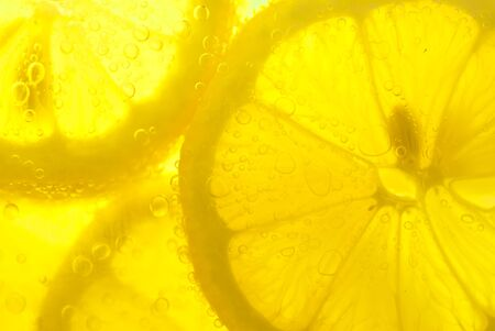 Macro of lemon in sparkling water.