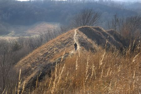loess: A lone hiker on the loess hills trail at Squaw Creek National Wildlife Refuge in Missouri. Taken November 2006.