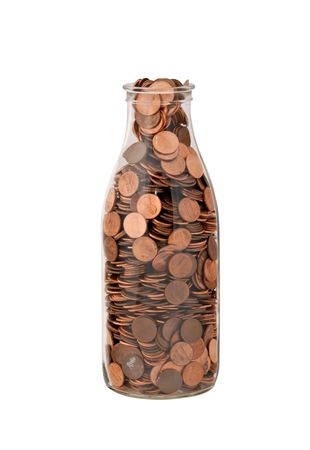 penny: Saved pennies in an old milk bottle. Isolated against a white background. Stock Photo