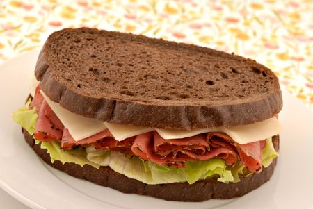 peppered: A sandwich of peppered beef deli meat on pumpernickel rye bread. Stock Photo