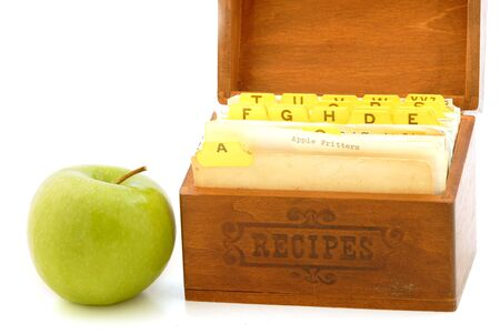 box: Recipe box with apple. Apple fritter recipe card showing. Stock Photo