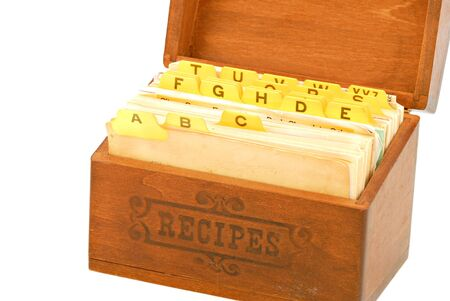 Old recipe box with recipes inside.