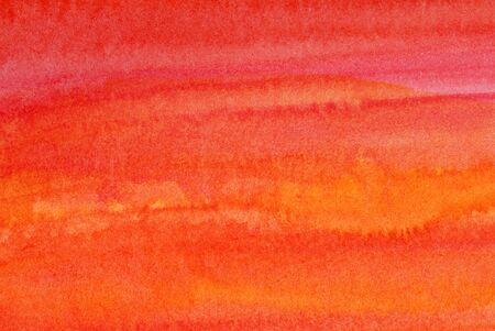 Photo of watercolor wash background in shades of orange and red.