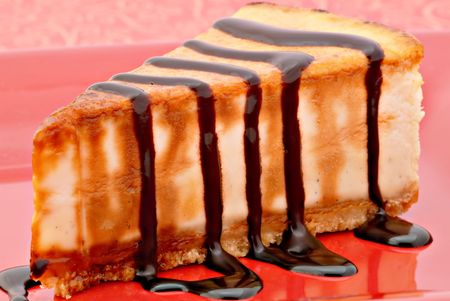 Rich creme brulee cheesecake with dark chocolate drizzled over the top. Yummm! Stock Photo