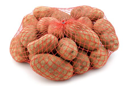 A red mesh bag of russet potatoes. Stock Photo