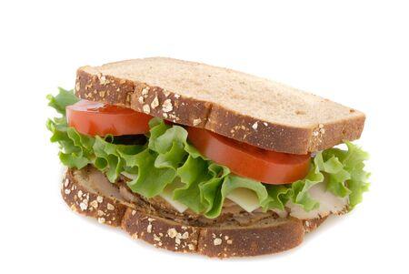 deli sandwich: Smoked turkey sandwich on whole grain oat bread.