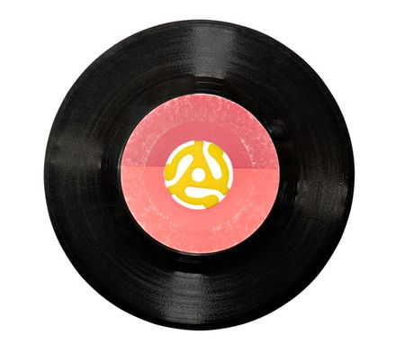 evident: An old 45rpm vinyl record with yellow plastic adapter. Age and scratches evident at 100%
