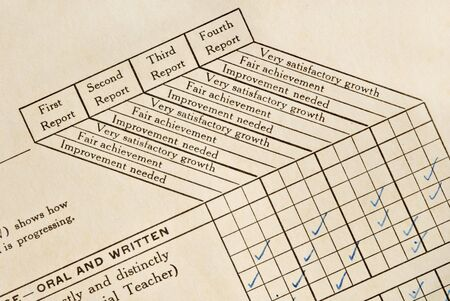 A very old childs report card on yellowing cardstock. Stock Photo