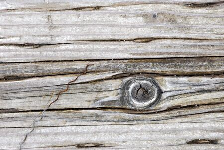 knothole: Wood planking with a knothole. A small rusty wire also seen. Stock Photo