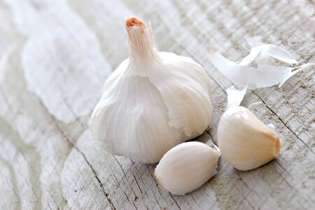 Garlic on weathered wood. Shallow depth of field.