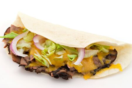 A beef soft taco on a white background.