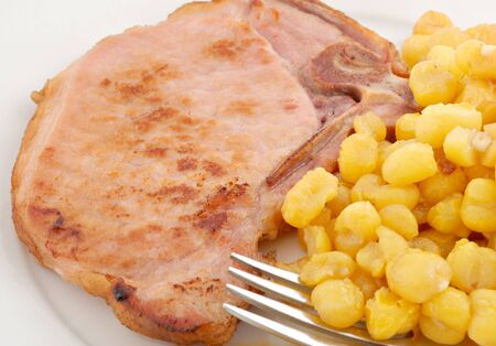 browned: Browned smoked pork chop with golden hominy.