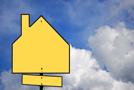 forsale: A blank house sign against a partly cloudy sky. Add your own text.