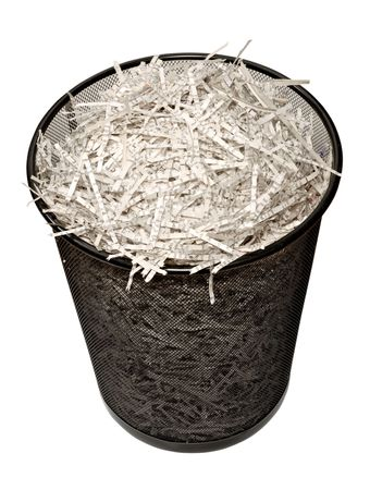 A wastebasket filled with shredded paper. Isolated on a white  with clipping path.