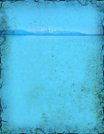 Grunge background of a mountain lake with plenty of room for text.