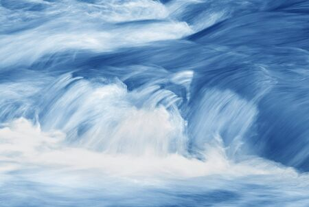 turbulent: A rushing stream in shades of blue. Stock Photo