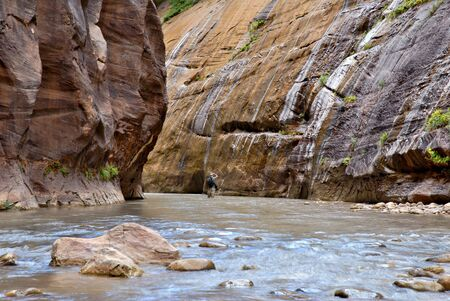 outside shooting: A photographer taking a picture in the Zion National Park Narrows.