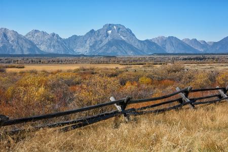 split rail: Mount Moran near the Cunningham cabin in the Grand Teton National Park Wyoming during the autumn season. Stock Photo
