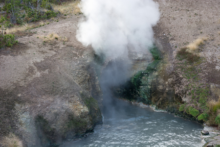 steam mouth: Dragons Mouth Spring in the Mud Volcano Stock Photo