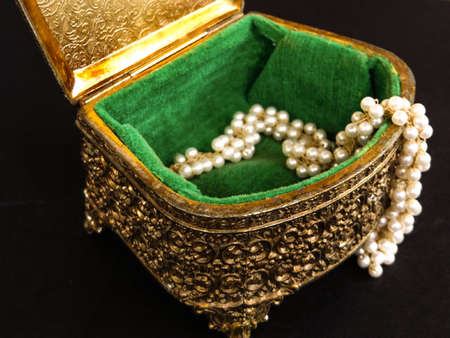 Vintage metal jewelry box with pearls